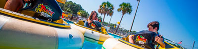 People riding bumper boats at The Track