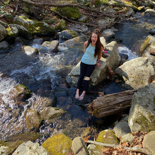 Me putting my feet in the water after a 14 mile hike
