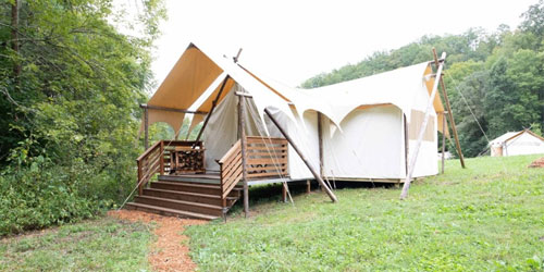 Exterior of a family-friendly white canvas tent at Under Canvas Great Smoky Mountians