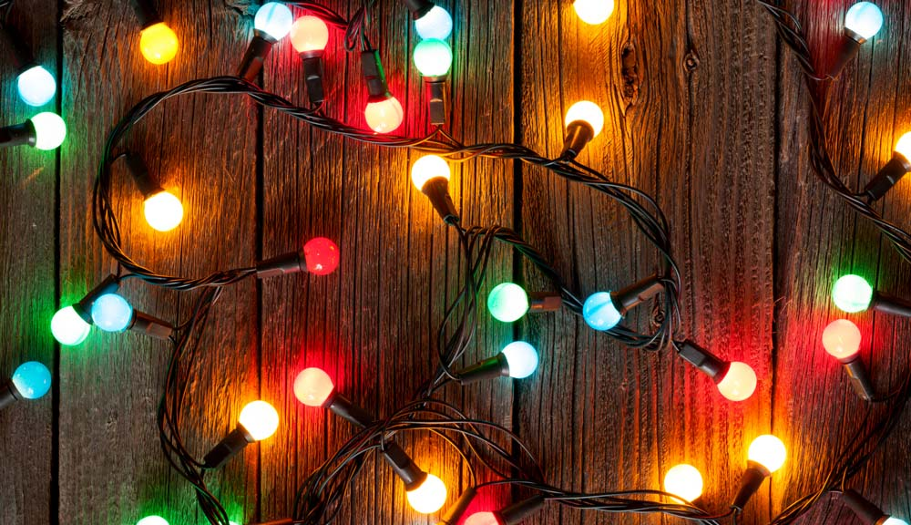 Colorful string lights on a wooden table