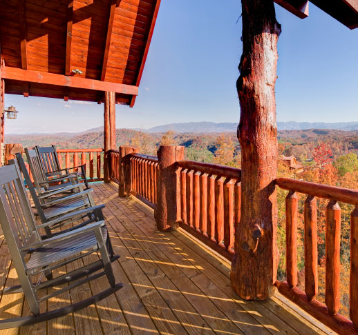View of mountain fall colors from a cabin balcony