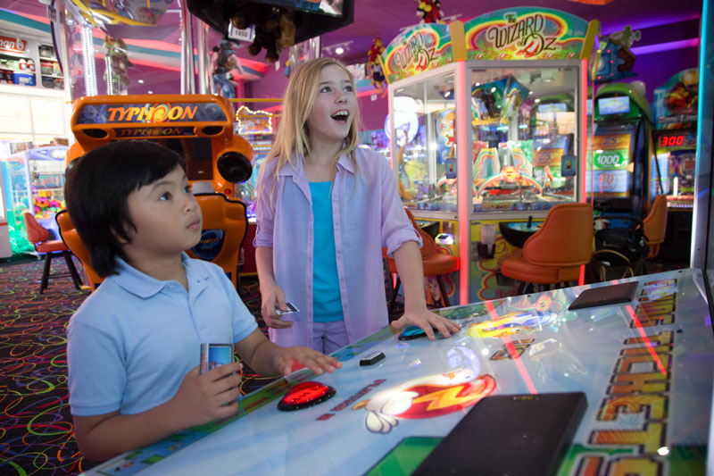Two excited kids in an arcade